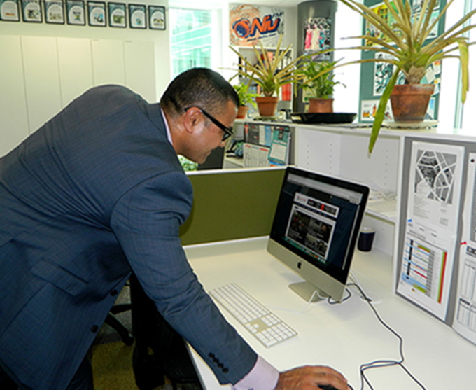 "Pacific Cooperation Foundation CEO Laulu Mac Leauanae turns the new AsiaPacificReport website ""live"" in Aucklland today. Image: Del Abcede/PMC"