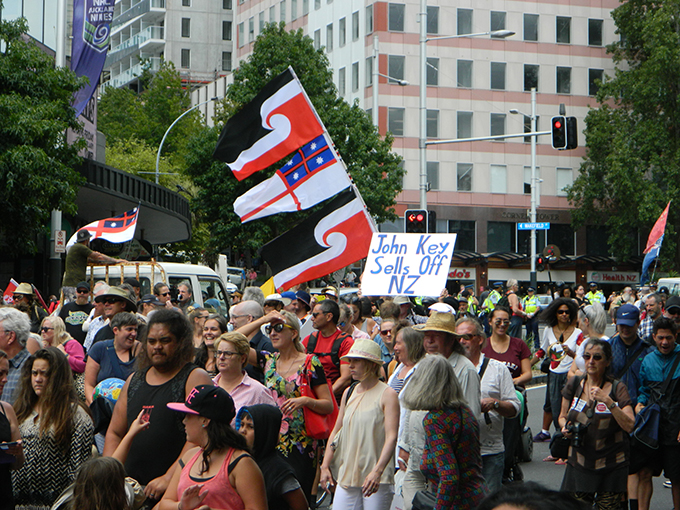 The tino rangatiranga flag and a message for Prime Minister John Key at the TPPA rally in Auckland today. Image: Del Abcede/PMC