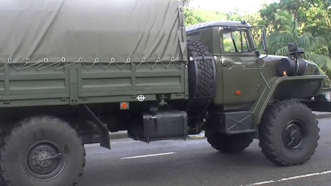 Newly donated Russian military trucks were used in the clean-up operation in Suva today, Image: Fiji One News