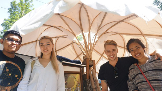 Architecture students Fauzan Alfi A, Stephanie Cheung, Laras Winarso and Matthew Hunter with a prototype of their street vendor shelter to be used in Indonesian cities. Image: Michael Neilson