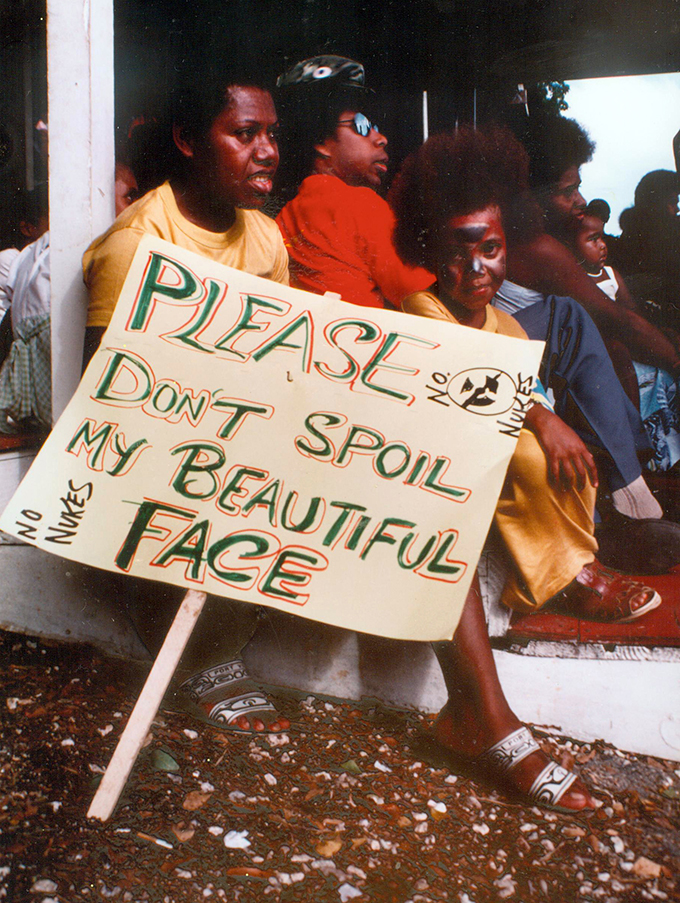 "June Keitadi with her family's ""No nukes"" placard at Independence Park, Port Vila, 1983. Photo: David Robie"