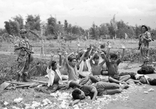 "Absence: An image not shown in the Netherlands: soldiers of the Absence: An image not shown in the Netherlands: soldiers of the Royal Dutch East-Indies Army KNIL next to wounded and dead Indonesian soldiers captured in Malang, East Java, in late July 1947.(Unidentified military photographer, DLC, National Archives, The Hague) Indonesian soldiers, in contrast, were portrayed by the magazines as ""roaming gangs""."