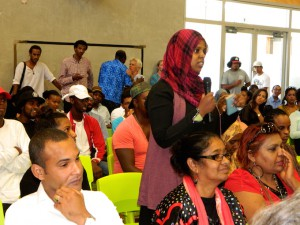 A young Somali woman asks a question at the African Youth Forum yesterday called to respond to a research report alleging NZ police are racially profiling young Africans. The tall man in the rear of the picture is Guled Mire, one of the organisers of the forum. Image: Del Abcede/PMC