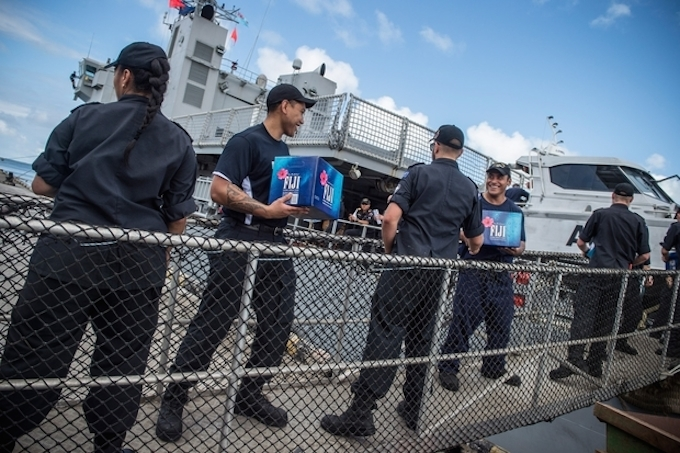 HMNZS Wellington being loaded with aid in Fiji post-Cylone Winston. Image: NZ Defence Force