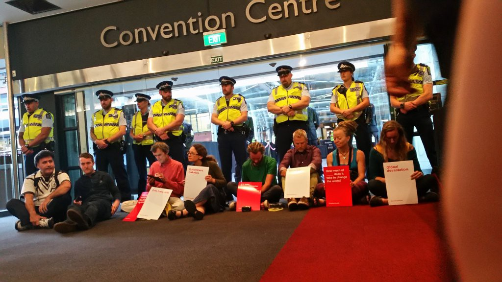 Protesters blockading the main entrance at Sky City today. Image: Greenpeace
