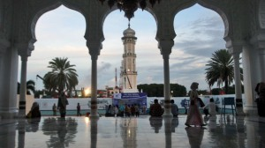 People gather at Baiturrahman Grand Mosque at dusk in Banda Aceh, Aceh province, Indonesia. A local law that makes gay sex punishable by public caning took effect in October last year. Image: AP
