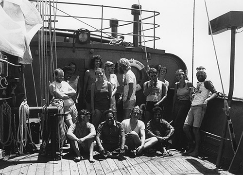 Skipper Peter Willcox with the Rainbow Warrior crew and others on board in the Marshall Islands weeks before the bombing. He is fourth from the right. Image: Fernando Pereira/Greenpeace