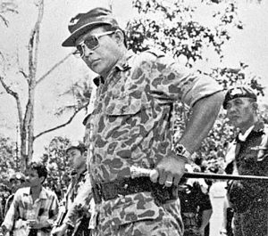 "Flashback: Major-General Suharto (right) led an operation to recover the bodies of five military generals who were killed and dumped into a well at the G30S coup headquarters called ""Lubang Buaya"" in the 1965 massacres. Image: Tempo Archive"