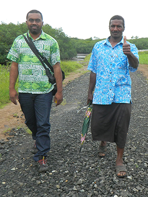 The Headman of the Daku village, Biu Naitasi, with Tuverea who is working with USAID/C-CAP. Image: Ami Dhabuwala/PMC