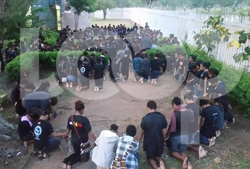 Students pray on campus while most students have been staging sit-in protests in groups. Image: LoopPNG