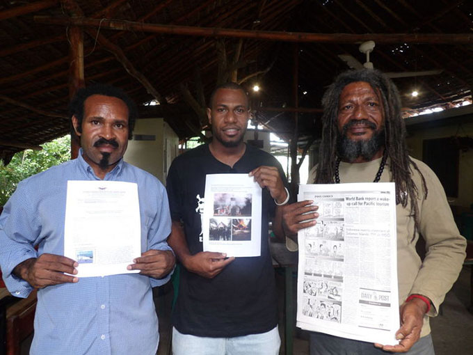 Liberation Army (TPNPB) Spokesman Sebby Sambom (from left); Free West Papua Association Coordinator Jacob Kintor; and Major-General Terrianus Satto display media releases about alleged human rights violations in West Papua. Image: Len Garae/Vanuatu Daily Post