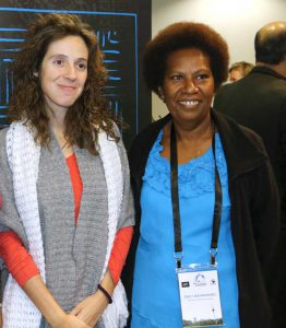 Maria Sagrista (Divine Word University, PNG) with UPNG journalism lecturer Emily Matasororo. Image: Image: Del Abcede/PMC