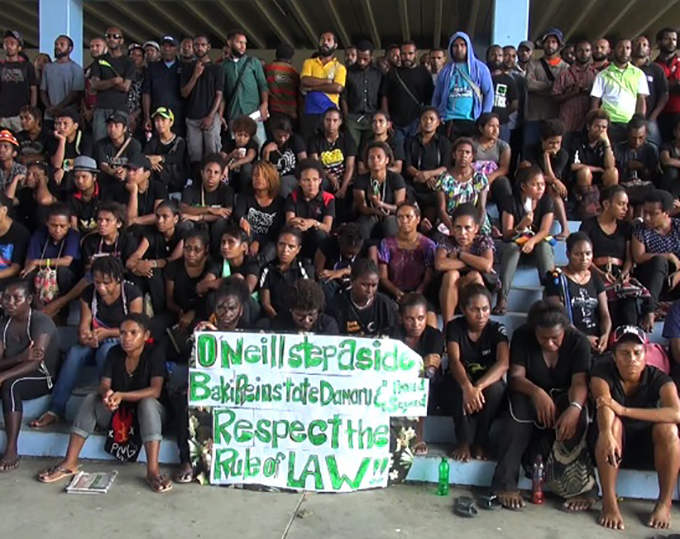 Students in the UPNG Forum with a message for Prime Minister Peter O'Neill at the height of the campus protests. Image: EMTV News
