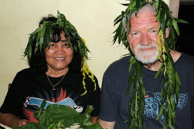 "Del Abcede and David Robie in ceremonial headdress - ""usually reserved for chiefs"" - at the welcome feast on Aneityum Island. Image: PMC"