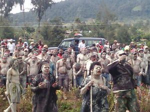 Mothers cover their faces and bodies in mud as a symbol of mourning for Graham Romanong. Image: Supplied