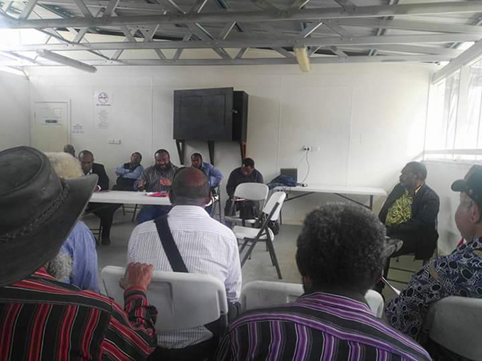 Augustine Mano chairing the meeting with landowners to review the petition.