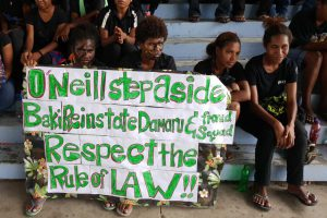 University of Papua New Guinea (UPNG) students holding a protest sign demanding the resignation of PM Peter O'Neill. Image: Supplied