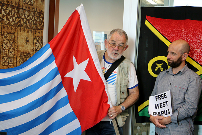 Kevin McBride of Pax Christi and Luqman Hayes of AUT Library's digital journal Tuwhera project at the West Papua flag-raising today. Image: Del Abcede/PMC