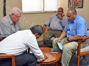 Fiji Times publisher Hank Arts (from left) and lawyer Feizal Haniff with CID officers Inspector Esili Nadolo (right) and Sergeant Laisiasa Tamani at The Fiji Times office in Suva last Thursday. Image: Jonacani Lalakobau/Fiji Times