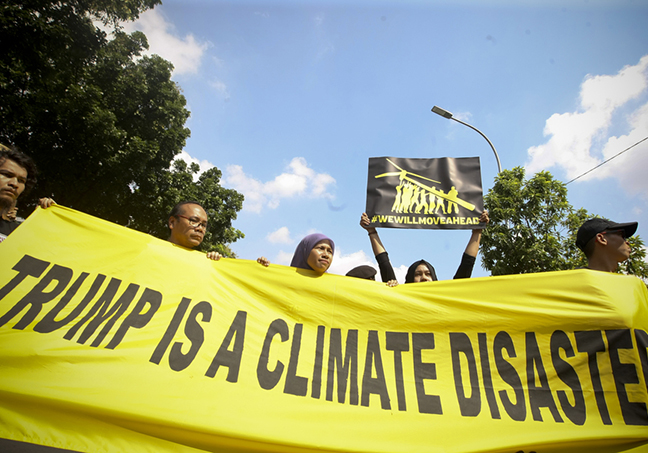 Protest banner outside the US Embassy says that Trumph is a climate ...