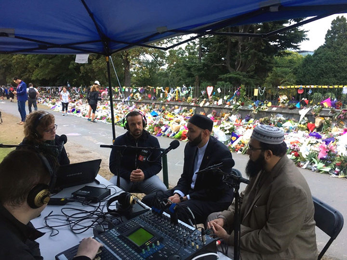 Susie Ferguson, Mohamed Hassan, Omar Suleiman and Qasim Rashid Ahmad discuss issues around the Christchurch mosque attacks from the RNZ special broadcast outside the Botanic Gardens. Image: RNZ