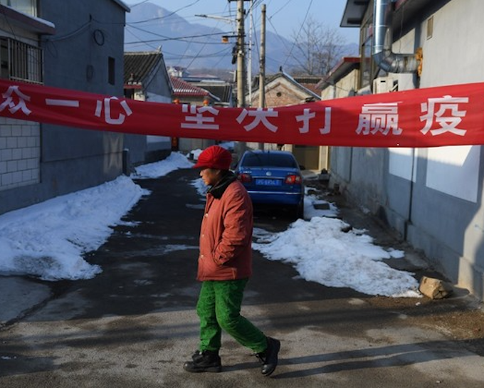China sees hope in virus 'war' as deaths top 1,100