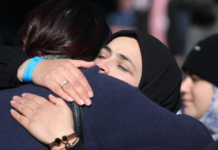 A supporter hug at Christchurch sentencing