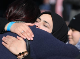 A supporter hug at Christchurch sentencing