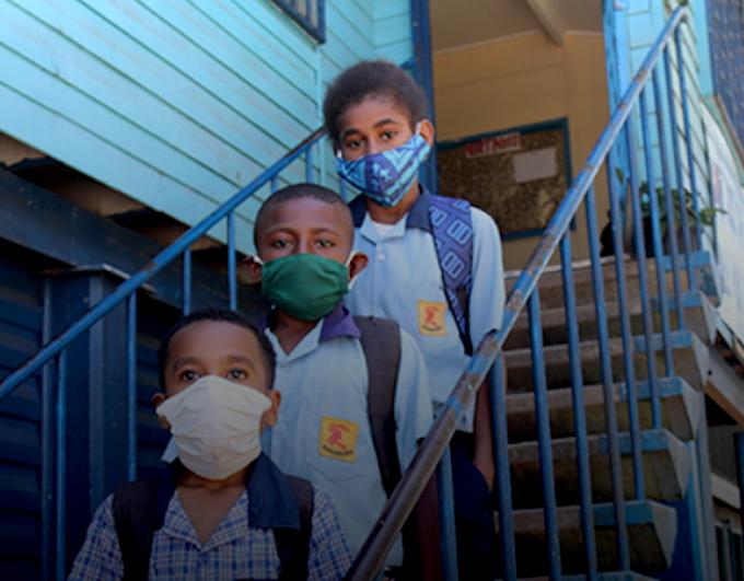 Masked PNG schoolchildren