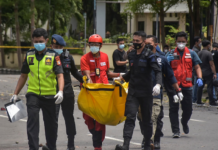 Indonesian police carry remains