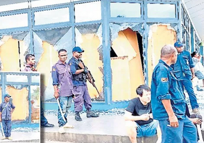 Police guard looted shop