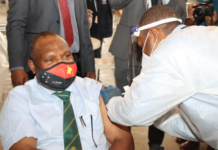 PNG Prime Minister James Marape being vaccinated