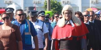 Samoan Chief Justice Satiu Simativa Perese walks to Parliament