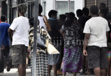 Fijians line up to access their F$90 government assistance