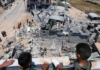Palestinian children and Gaza bomb site