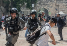 sraeli police chase a Palestinian demonstrator