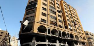 The damaged Al Jawhara Tower in Gaza City