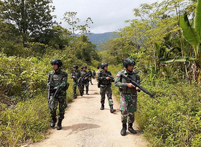 Indonesian soldiers on patrol in West Papua