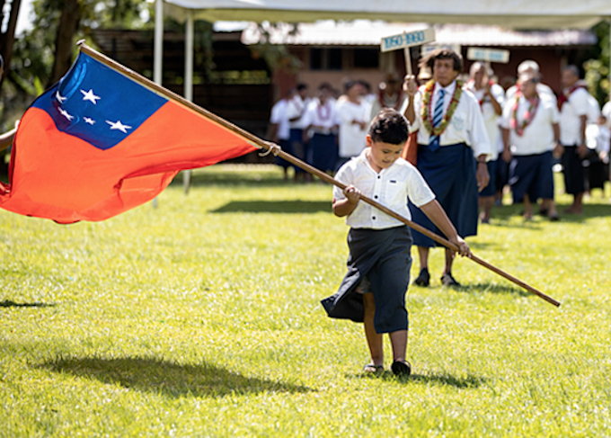 Samoan flag and child
