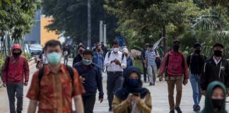 Masked office workers in Jakarta