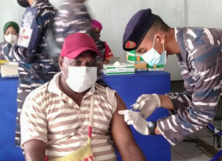 A Papuan man being vaccinated at Sorong, West Papua