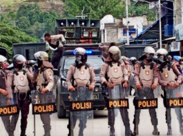 Indonesian riot police crackdown on UNCEN students.