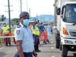 Fiji police at the Lomolomo border