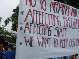 Lae workers protest against covid jab
