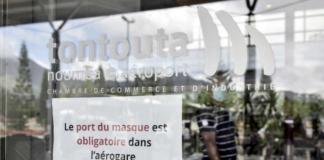 A facemasks compulsory sign at Tontouta Airport
