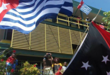 The West Papuan and PNG flags